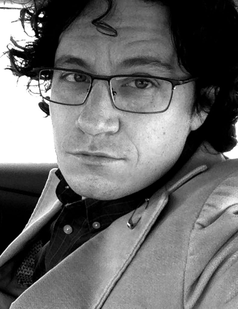 B&W photograph of author Michael J. DeLuca